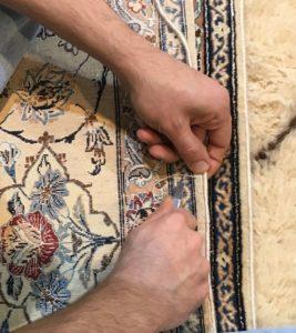 Restauration des bordures d'un tapis à saint Cloud